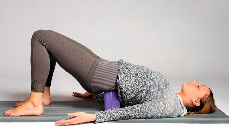 Supported Bridge Pose for a Pinched Nerve in the Lower Back or Hips