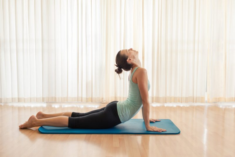 Bhujangasana — Cobra With A Roll Between Legs AndOr Under Belly Pose