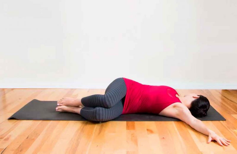 Supta Matsyendrasana — Reclined Spinal Twist Pose