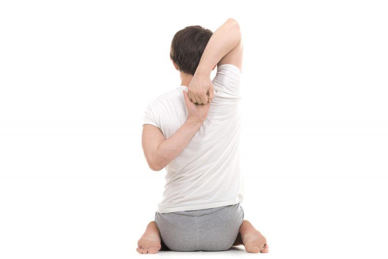 Gomukhasana in Virasana — Shoulder Stretch Pose